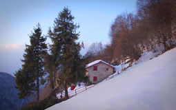 Rural house - Wintry Alps Royalty Free Stock Photography