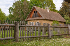 Rural house with wooden fence Royalty Free Stock Image