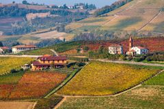 Rural houses amomg autumnal hills of Piedmont. royalty free stock photo