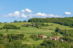Rural houses on green pasture in Piedmont, Italy. Royalty Free Stock Images