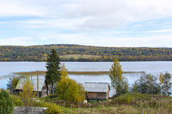 Rural houses on lakeside in taiga Stock Photo