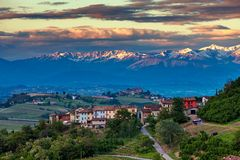 Rural houses and mountain ridge on background in Italy. Royalty Free Stock Photo