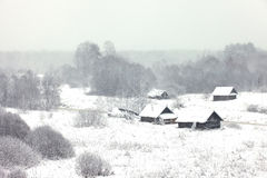Rural houses under the snow Royalty Free Stock Images