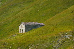 Rural hut in the mountain pasture. Stock Photos