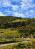 Rural image. Hilly farming area under a blue sky, partially cloudy Stock Photos