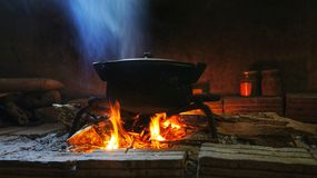 Rural image pot of food on fire Royalty Free Stock Photo