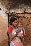 Rural India. June 02,2011 Rampurhut,Birbhum,West Bengal,India,Asia- A adolescent mother holding her child in a tribal village of West Bengal Stock Images