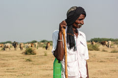 Rural Indian man traditional attire. Man in photo is of Bharwad community a tribe of Gujarat, India. They live kind of nomads life. nnA Indian gypsy man at work Stock Photography