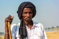 Rural Indian man traditional attire. Man in photo is of Bharwad community a tribe of Gujarat, India. They live kind of nomads life. nnA Indian gypsy man at work Stock Images