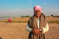 Rural Indian man traditional attire. Man in photo is of Bharwad community a tribe of Gujarat, India. They live kind of nomads life. nnA Indian gypsy man at work Stock Image