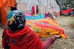 Rural Indian Women drying sari Stock Photos