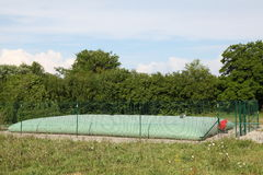 Rural Inflatable Water Storage Tank. An inflatable green water storage tank in an agricultural area used to store water for fighting grass fires which can expand Royalty Free Stock Photography