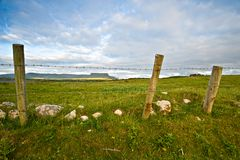 Rural Ireland. Rural scene from Co.Sligo, Ireland, showing fence and fields with mountains in far distance Stock Image
