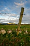 Rural Ireland. Rural scene from Co.Sligo, Ireland, showing fence post with barbed wire and fields with mountains in far distance Stock Photos