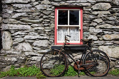 Rural ireland in the old days. Old bicycle by rural cottage wall Stock Photo