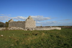 Rural Irish cemetery. Ruins of old cemetery and very old church in the west of ireland Stock Photo