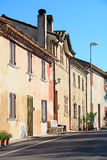 Rural Italy. Old houses lining a street in early sun Royalty Free Stock Photos