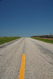 Rural Kansas. An old paved road running through the heart of the Kansas landscape Royalty Free Stock Photo