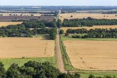 Rural Kansas road. Through wheat fields; view from Coronado Heights Stock Photos