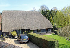 Rural kent thatched cottage Stock Image