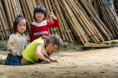 Rural kids playing outside house Stock Photo
