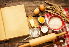 Rural kitchen baking cake ingredients and blank cook book royalty free stock image