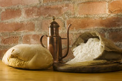 Rural kitchen with bread and flour Stock Image
