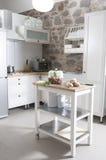 Rural kitchen interior in old village. In white Stock Photos