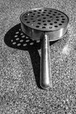 Rural kitchen utensil - strainer on the table. Royalty Free Stock Photography