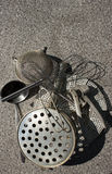 Rural kitchen utensil - strainers on the table with free text space. Stock Photos