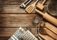 Rural kitchen utensils on vintage planked wood table. From above - rustic background with free text space stock photography