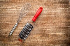 Rural kitchen utensils on vintage planked wood Royalty Free Stock Images