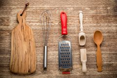 Rural kitchen utensils on vintage wood table from Stock Photo