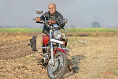 Rural Landcape with senior on a motorcycle Stock Image