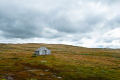 Rural landscape. An old shed in rural norwegian landscape Royalty Free Stock Photo