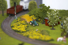 Rural landscape. Breadboard model of a rural landscape with a tractor and a farm and the railway Stock Image