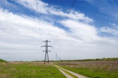 Rural landscape. Landscape: road,  field, clouds and electric column Royalty Free Stock Photography