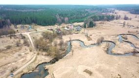 Rural landscape in april. Small River in early spring. Rural landscape in april. Small River Sula in early spring. Aerial view of brook bends in a medow. Belarus stock video