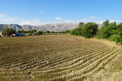 Rural landscape arable plow field. And mountains behind. Rural area, countryside Stock Photography