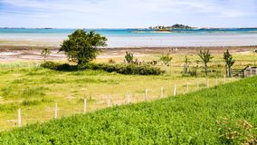 Rural landscape on Atlantic coast in Brittany. Travel to France - rural landscape on coast of Anse de Beauport bay in Kerity district of Paimpol town in Cotes-d' Stock Photography