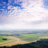 Rural landscape background with plant fields and majestic clouds Royalty Free Stock Photos