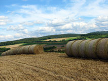 Rural landscape with bales of hay Stock Images