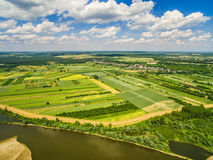 Rural landscape with a bird rally. Fields stretching to the horizon. Vistula river and countryside landscape from bird`s eye view stock image