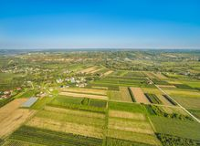 Rural landscape with bird`s eye view. Small farmland stretching to the horizon. Rural landscape with bird`s-eye view, with crop fields visible. Rural landscape royalty free stock image