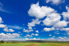Rural landscape with blue sky and clouds Stock Photos