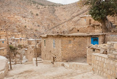 Rural landscape with brick houses in mountain village Palangan, Iran Royalty Free Stock Image