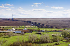 Rural landscape with cattle-breeding farm and the drilling derrick. View from above Royalty Free Stock Photo