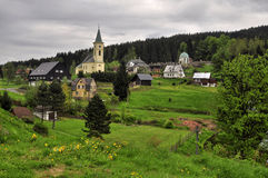 Rural landscape. Rural landscape with a church and cemetery. Albrechtice v Jizerskych Horach - Czech Republic Royalty Free Stock Image