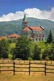 Rural landscape with church in Maddalena. Liguria, Italy with alpine background Stock Photo