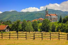 Rural landscape with church in Maddalena. Liguria, Italy with alpine background Royalty Free Stock Photos